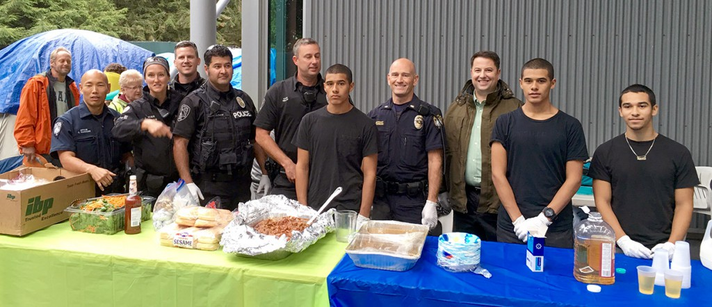 TDHS Volunteers and Bellevue Police Department Officers Serve a Warm Meal to the Residents of Tent City Four